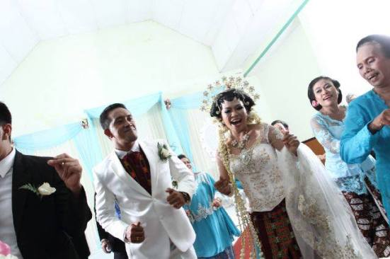 dancing with the bride and bridegroom